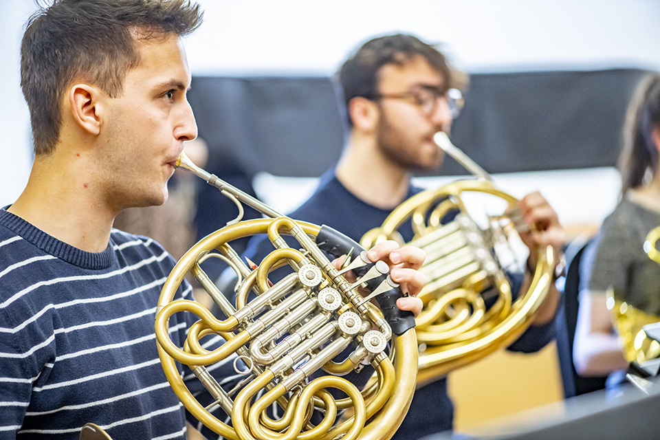 Horn players in rehearsal