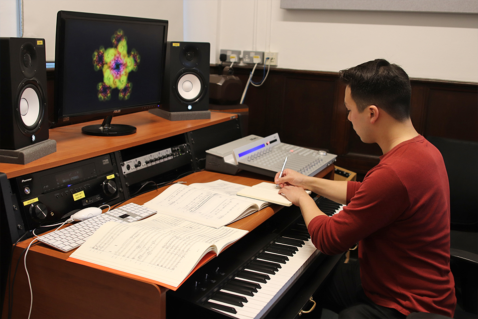 Andrew Chen sitting in an RCM composition suite