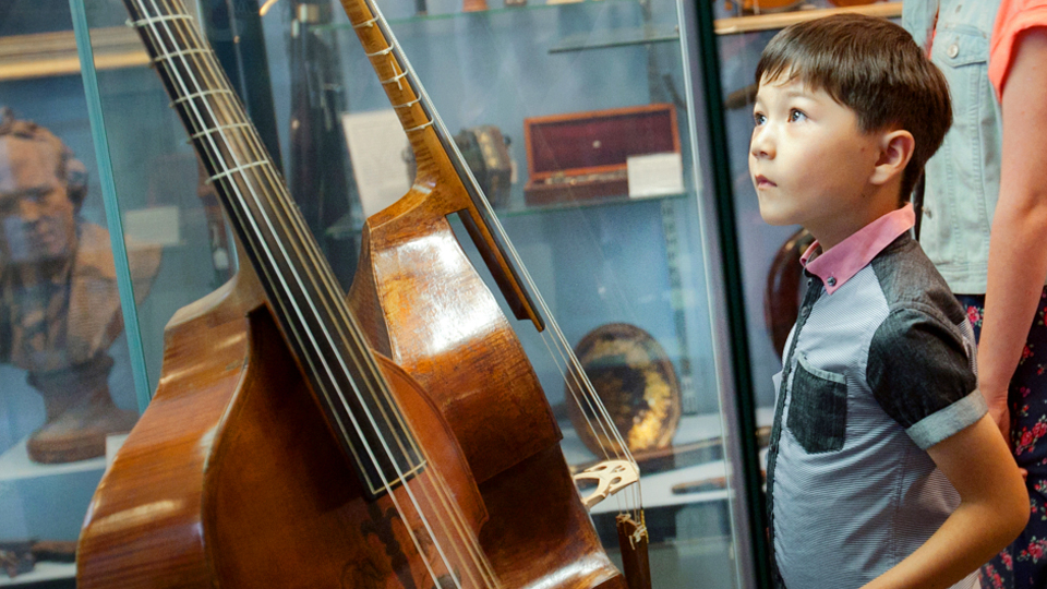 Child looking at viols
