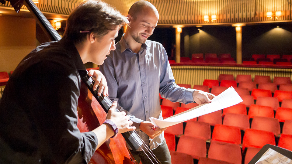 An RCM composer working with a double bassist in the Britten Theatre