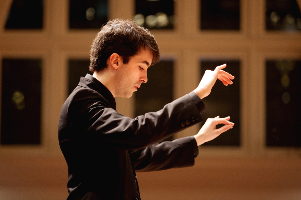 Postgraduate student Asier Puga conducting during a public performance in the Amaryllis Fleming Concert Hall