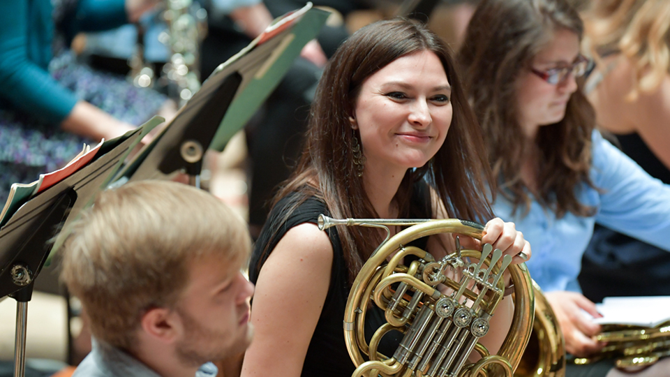 EU student playing principal horn in the RCM Symphony Orchestra