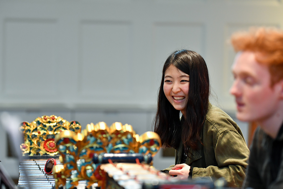 A student playing gamelan during the Percussion Showcase
