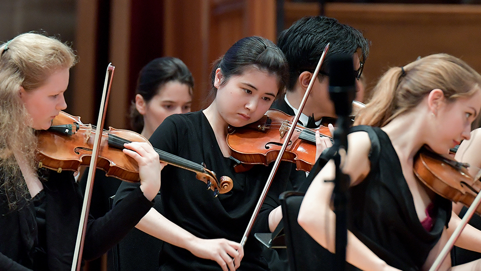 Japanese violinist in orchestra