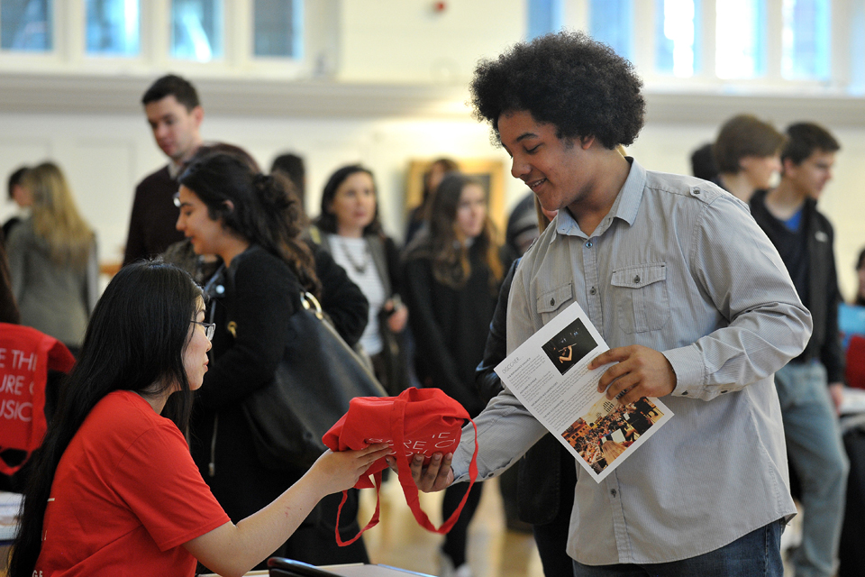 Visitor attending Royal College of Music Open Day receiving an information pack