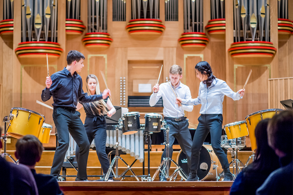 Percussion ensemble performing in front of the RCM organ