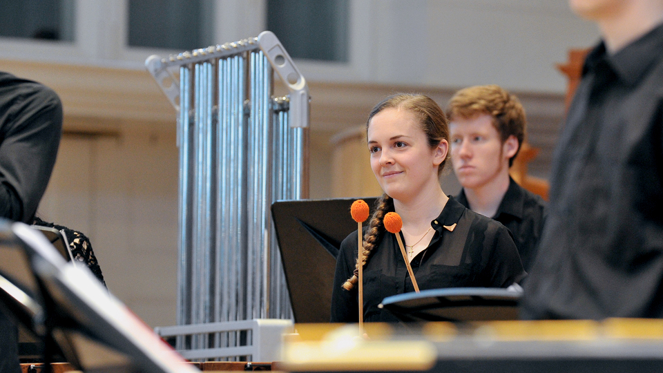 An RCM percussionist in the percussion ensemble