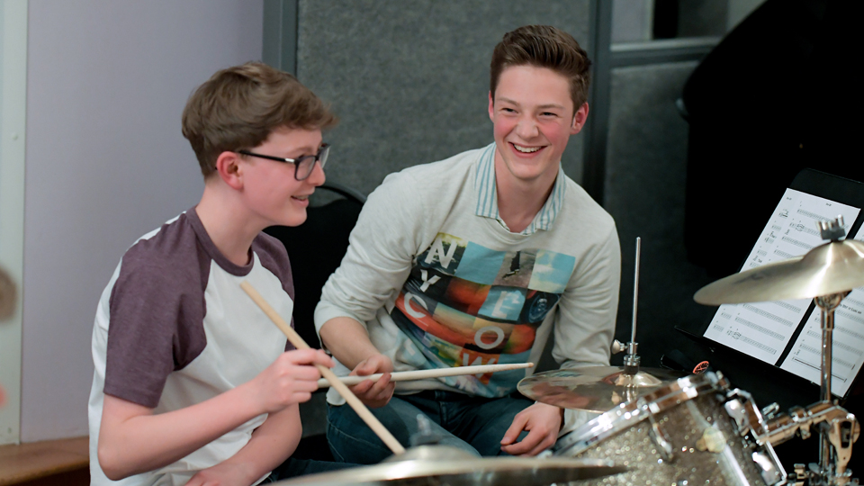 Two Junior Department drummers enjoying lessons