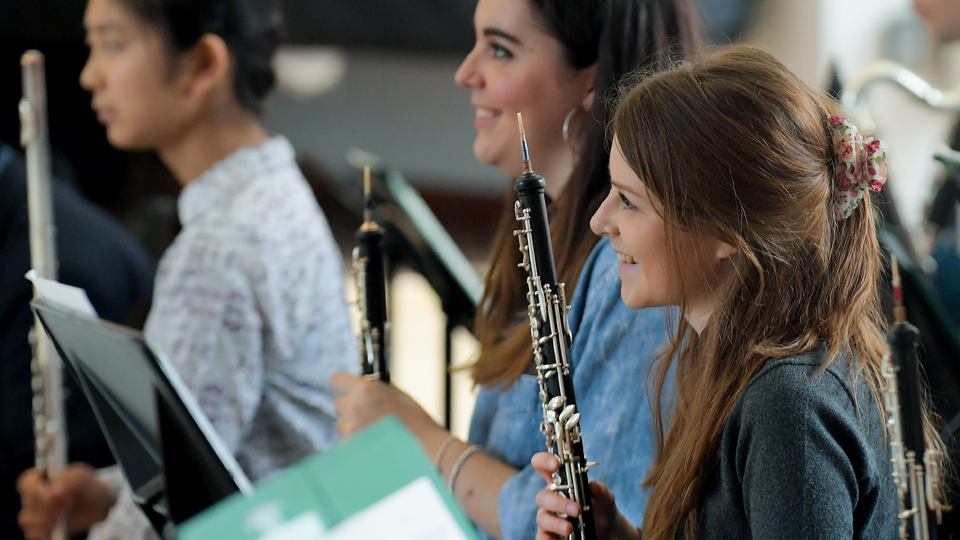 Two Junior Department oboists enjoy their rehearsal