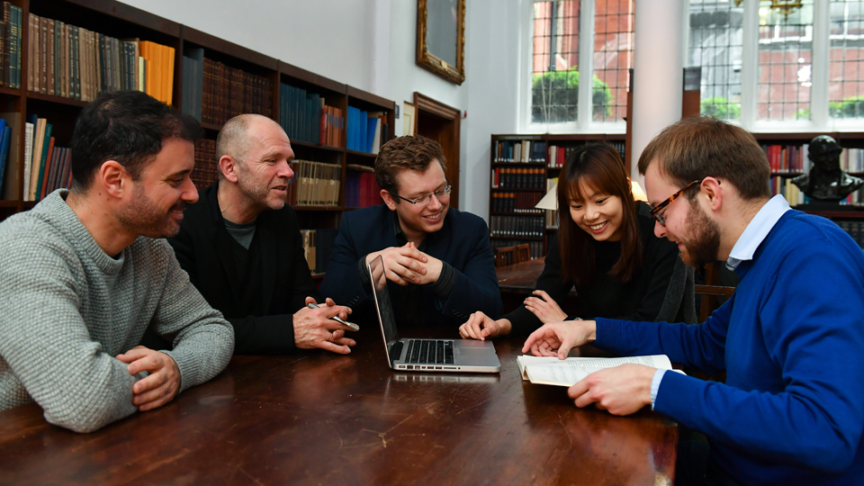 A group of RCM researchers working in the library's Donaldson Room