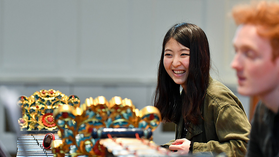 Korean student playing gamelan