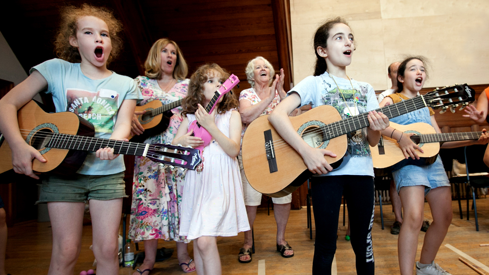 Children playing guitars at a Sparks Family Create event