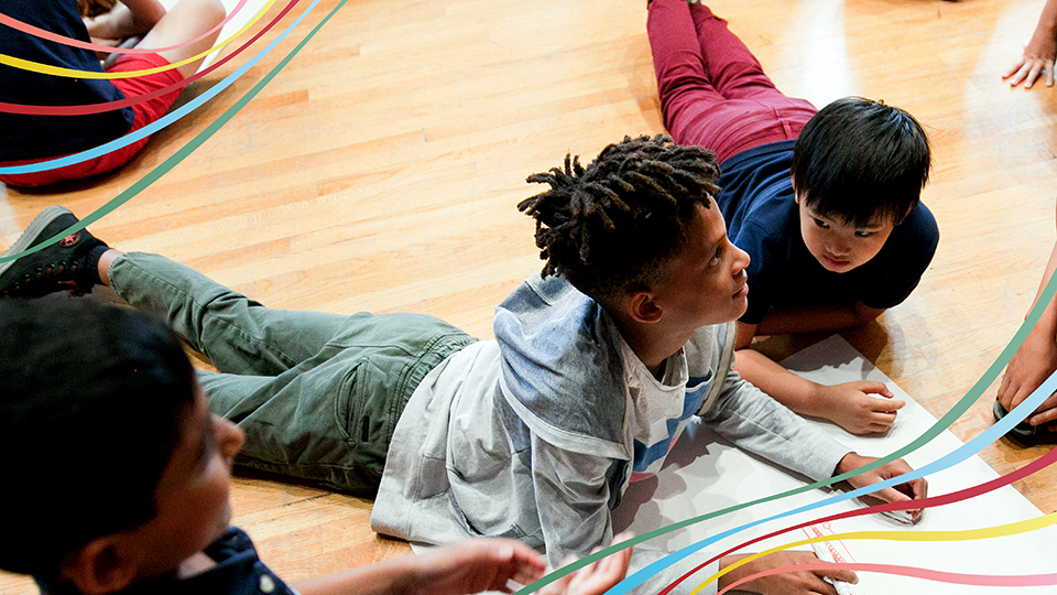 Two boys interacting at an RCM Sparks event