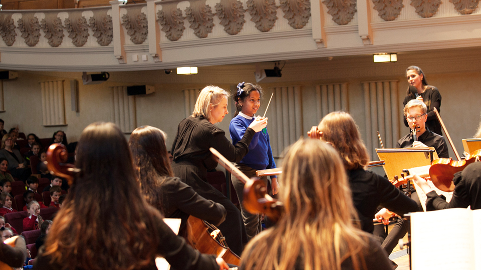 Pupil conducting at a Sparks lunchtime concert for schools
