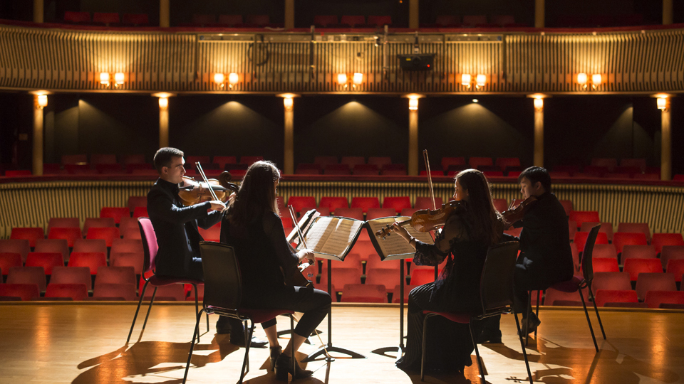 RCM string quartet playing on the stage of the RCM Britten Theatre