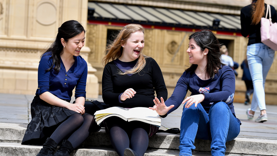 Students laughing on Royal Albert Hall steps
