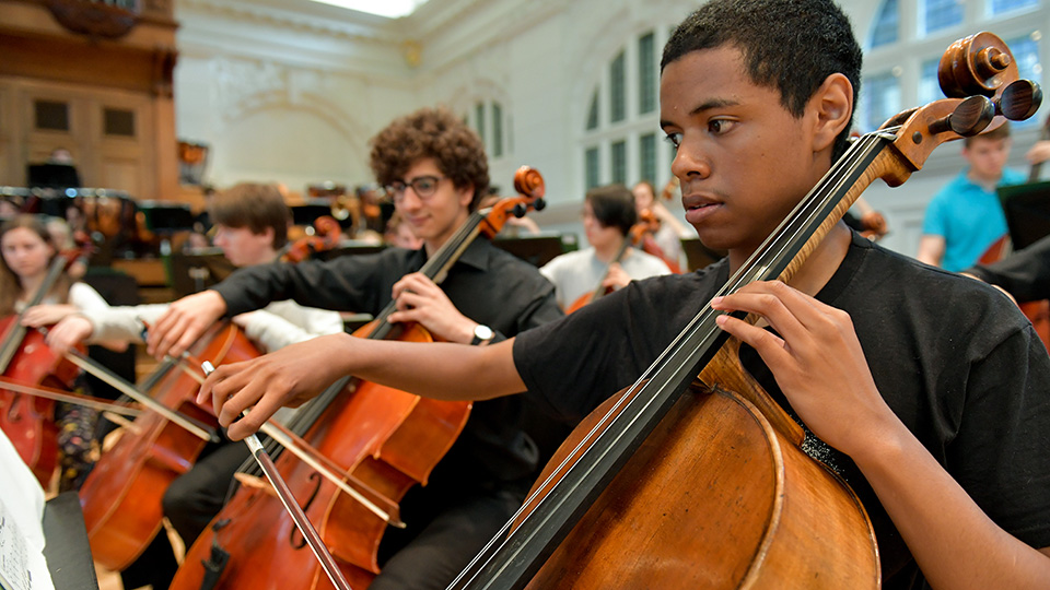 Junior Department cellists in an orchestra rehearsal