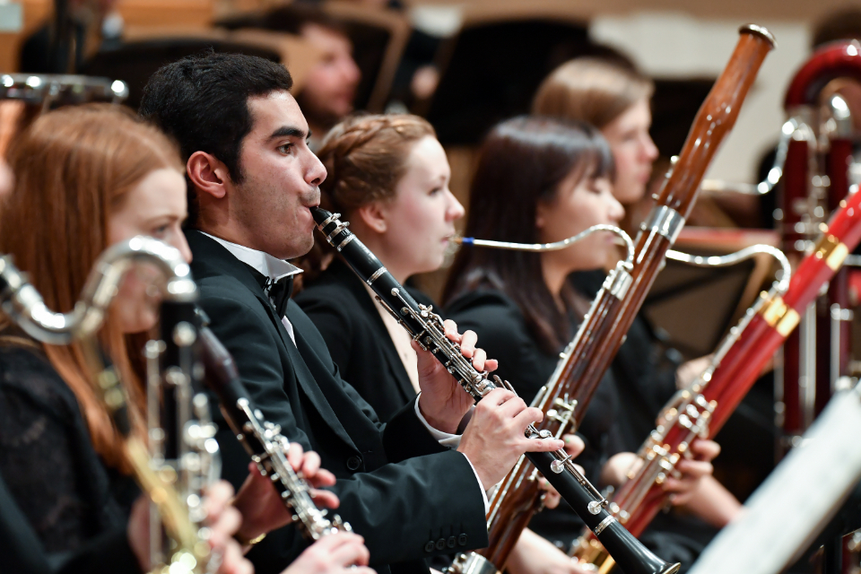 Woodwind musicians performing with the RCM Symphony Orchestra
